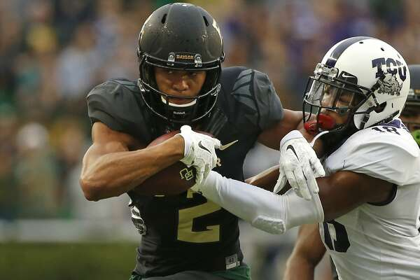 WACO, TX - NOVEMBER 5: Blake Lynch #2 of the Baylor Bears makes a catch and tries to escape from Nick Orr #18 of the TCU Horned Frogs in the first half at McLane Stadium on November 5, 2016 in Waco, Texas. (Photo by Ron Jenkins/Getty Images)