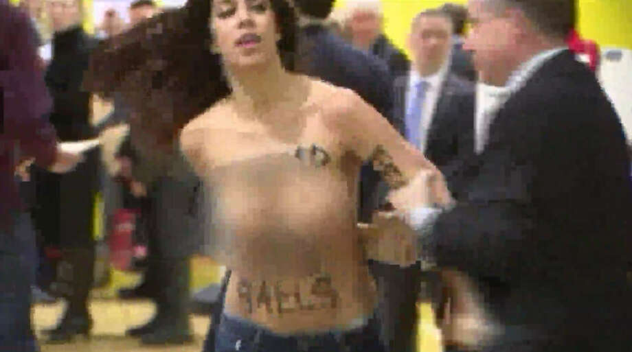 The polling station where Donald Trump is expected to vote was visited by a pair of women, naked from the waist up, who were protesting the Republican presidential candidate. Photo: WPIX Via Inform