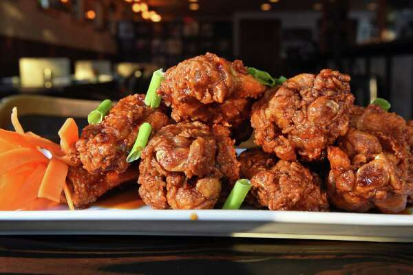 Korean wings at Kraverie on Beekman Street Friday Nov.4, 2016 in Saratoga Springs, NY.  (John Carl D'Annibale / Times Union)