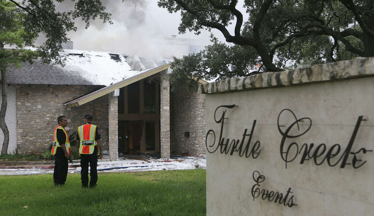 San Antonio firefighters work to extinguish a fire Tuesday November 8, 2016 at the Turtle Creek Events building at 3830 Parkdale. A second alarm was called at the fire. Arson is investigating the blaze. Flames could be seen coming through the roof from what appeared to be attic space.