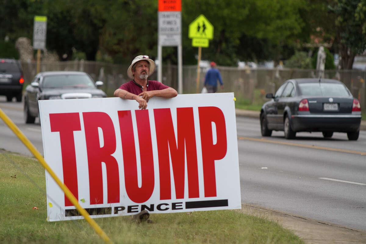 Armando Benavides with a Trump sign outside the Las Palmas Library voting location, Tuesday, Nov. 8, 2016.