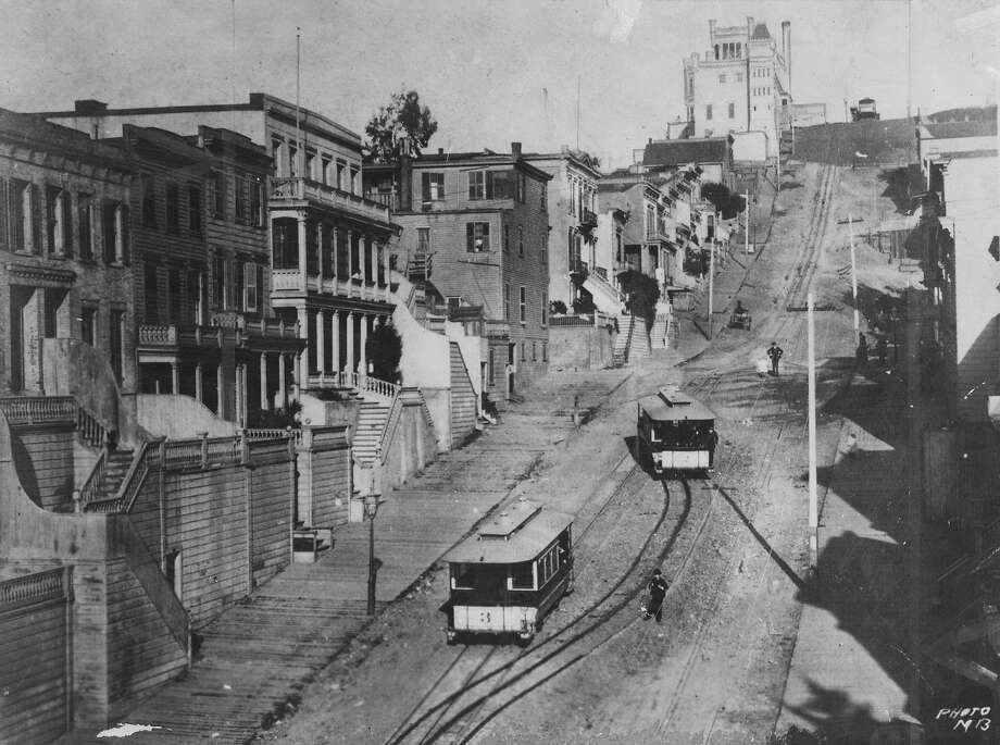 """From the caption on  the back:  """"John L., Old Biceps himself, used to take (or push) a cable car up Telegraph Hill to monstrous old """"German Castle,"""" a tavern for prizefighters and sports. Once operated (unsuccessfully by Comstock tycoon Adolph Sutro, the castle stood atop Greenwich Street. Photo: Photographer Unknown, San Francisco Chronicle"""