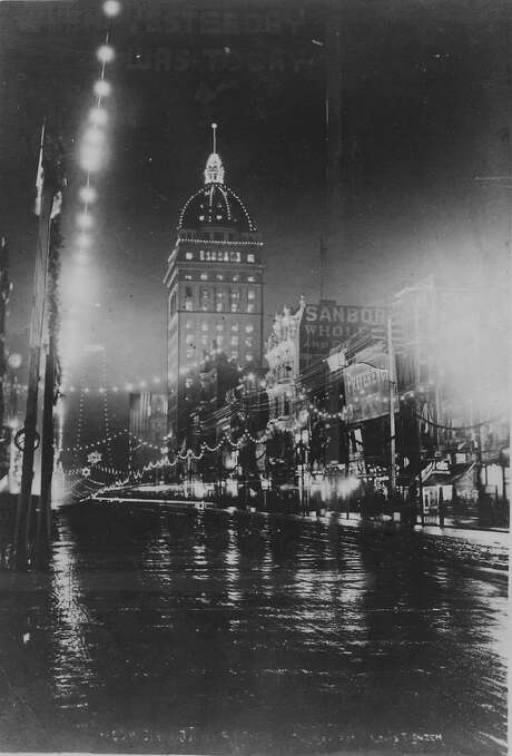Market Street in San Francisco, all lit up as a Great White Way for the Golden Jubilee of the N.S.G.W, September 1900. The illuminated structure is the Call Building. Photo: Chronicle Archives