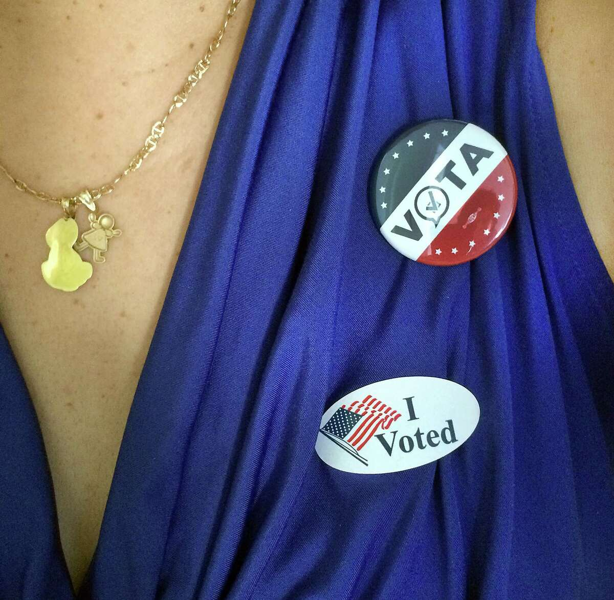 """Rosa Gutierrez, 50, of Danbury, a native of Puerto Rico, wears her """"I Voted"""" stickers - in both English and Spanish, Tuesday, Nov. 8, 2016."""