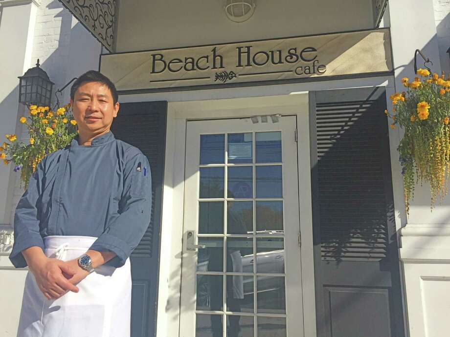 Kane Xu, the new owner and chef of Old Greenwich's Beach House Cafe. The restaurant and bar will keep its name but the menu has been transformed. Photo: Macaela Bennett / Hearst Connecticut Media