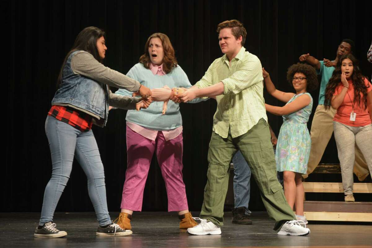 A church Christmas pageant director played by Kimber Vanek, center, tries to keep siblings portrayed by Jade Jacobo and Nathaniel Taylor from ripping the doll that's meant to portray baby Jesus in Dobie High School's production of
