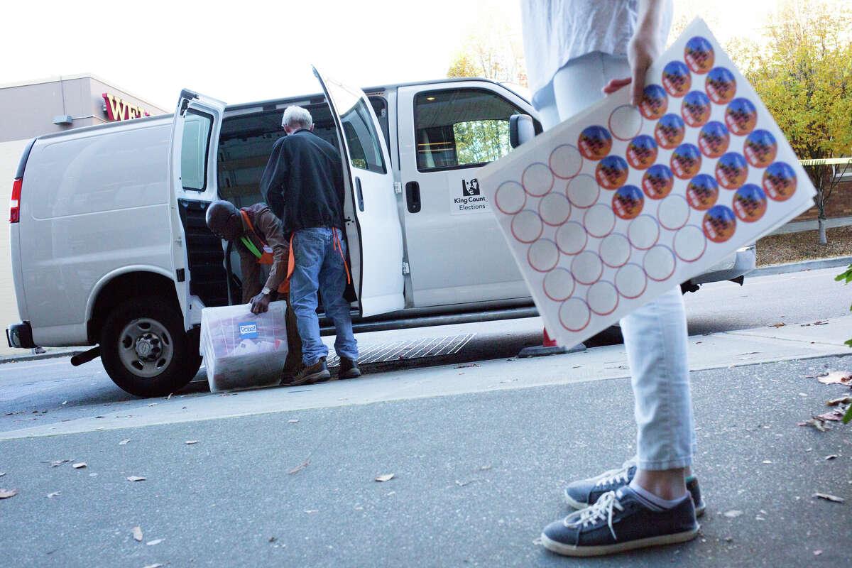 Mark Briggs and Omollo Gaya load up a van of ballots to take to a counting facility, Tuesday, Nov. 8, 2016.