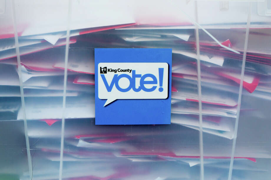 Cast ballots are sealed in plastic containers as they are collected outside Schmitz Hall at University of Washington, Tuesday, Nov. 8, 2016. Photo: GRANT HINDSLEY, SEATTLEPI.COM / SEATTLEPI.COM