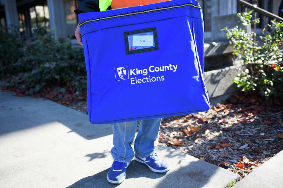 Jimmy Steele waits for ballots for King County Elections near a ballot dropbox outside Schmitz Hall at University of Washington, Tuesday, Nov. 8, 2016. Photo: GRANT HINDSLEY, SEATTLEPI.COM / SEATTLEPI.COM