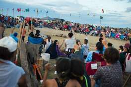 Members of the Standing Rock Sioux tribe and their supporters gather in a circle in the center of camp to hear speakers and singers, at a protest encampment near Cannon Ball, North Dakota where members of the tribe and their supporters have gathered to voice their opposition to the Dakota Access Pipeline (DAPL), September 3, 2016. Drive on a state highway along the Missouri River, amid the rolling hills and wide prairies of North Dakota, and you'll come across a makeshift camp of Native Americans -- united by a common cause. Members of some 200 tribes have gathered here, many raising tribal flags that flap in the unforgiving wind. Some have been here since April, their numbers fluctuating between hundreds and thousands, in an unprecedented show of joint resistance to the nearly 1,200 mile-long Dakota Access oil pipeline. / AFP PHOTO / Robyn BECKROBYN BECK/AFP/Getty Images