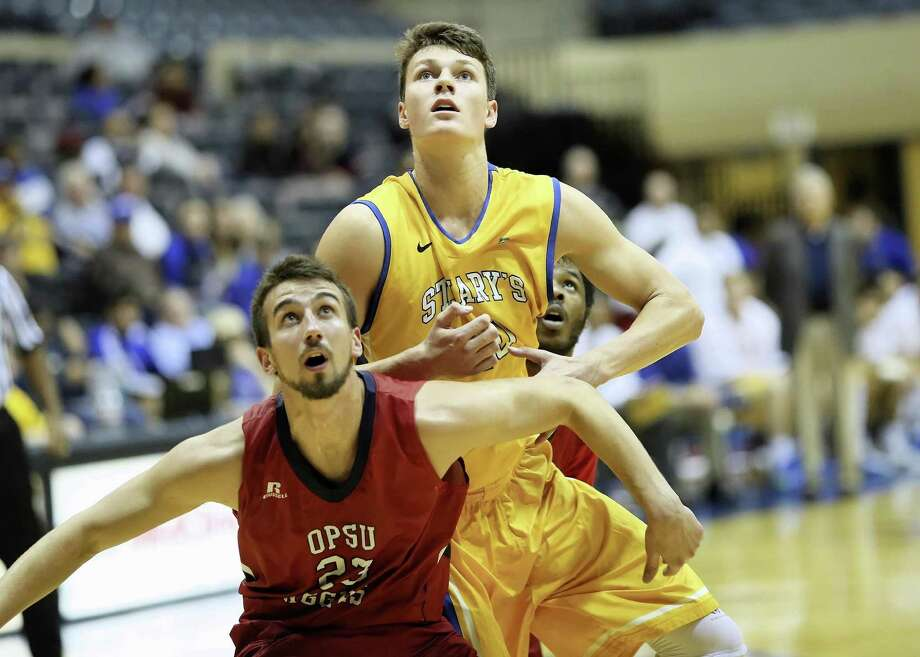Yanni Wetzell (top), shown in action during the 2015-16 season, was a world-ranked youth tennis player, but at 6-foot-10, basketball was calling. The New Zealand native is now a starting forward for the St. Mary's Rattlers. Photo: Courtesy Photo /Antonio Morano