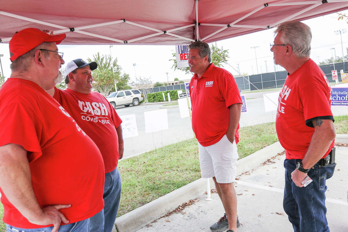 Philip Cash, candidate for Precinct 1 Constable, second from the right, chats with supporters Joe Kroll, Poncho Viniarski and Donnie Russell during early voting on Saturday, Oct. 29, 2016, at the North Montgomery County Community Center in Willis, Texas.