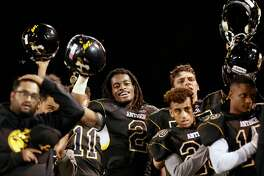 Helmets up Najee Harris, 2 and his teammates during the National Anthem before the start of the game as the Antioch Panthers take on the Heritage Patriots in Antioch, California on Friday October 28, 2016.