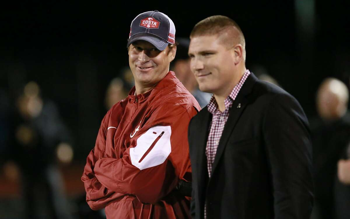 Former University of Alabama offensive coordinator Lane Kiffin, (left) and linebackers coach Tosh Lupoi came to watch star running back Najee Harris play as the Antioch Panthers take on the Heritage Patriots in Antioch, California on Friday October 28, 2016.