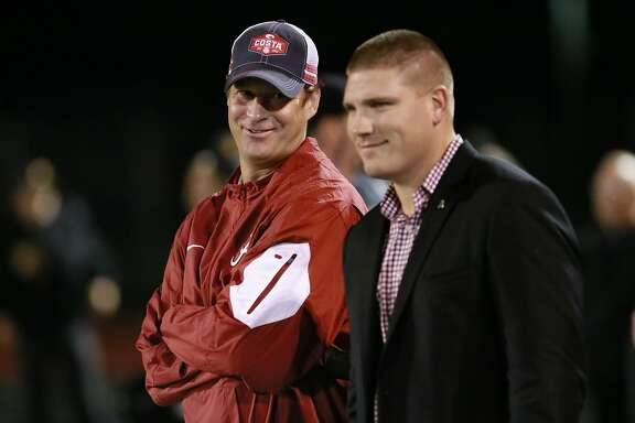 University of Alabama offensive coordinator Lane Kiffin, (left) and linebackers coach Tosh Lupoi came to watch star running back Najee Harris play as the Antioch Panthers take on the Heritage Patriots in Antioch, California on Friday October 28, 2016.