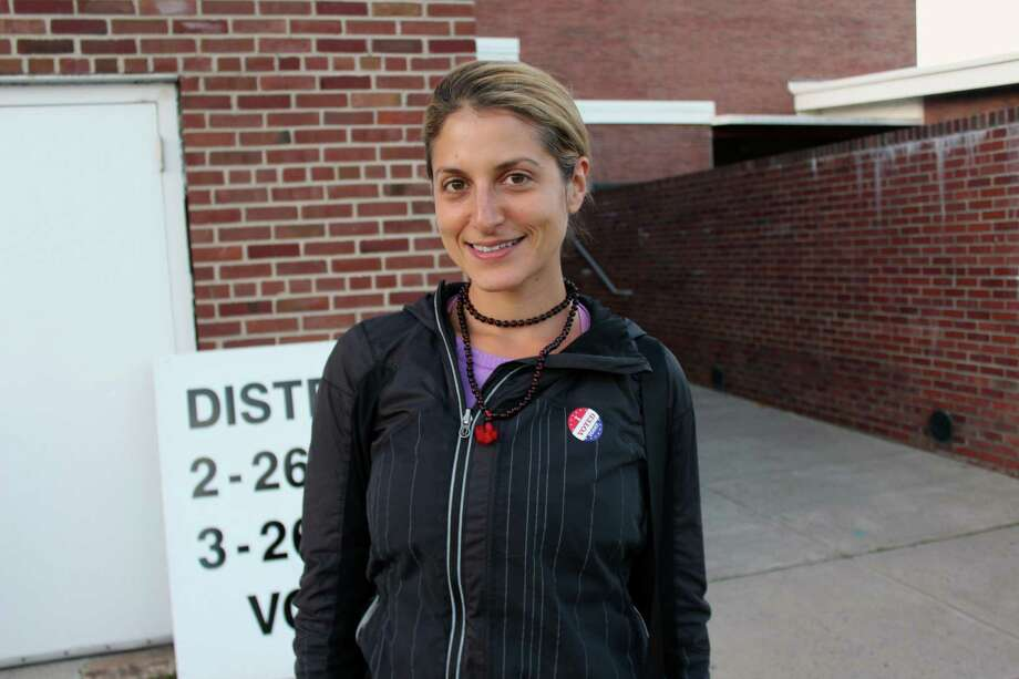 Amanda Nisenson cast her ballot at Saxe Middle School in New Canaan. Photo: Justin Papp / Hearst Connecticut Media / New Canaan News