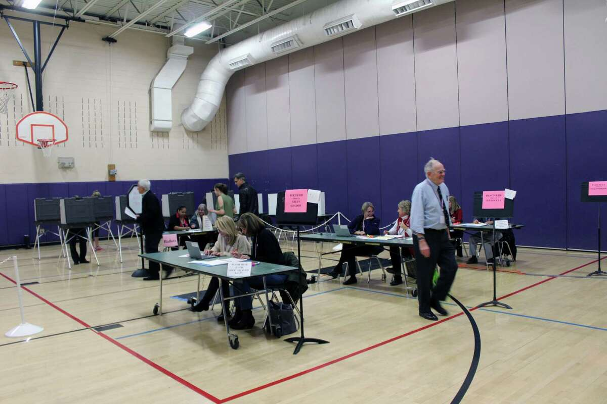 District 2 voters cast their ballotts at Saxe Middle School around 5 p.m. on Tuesday in New Canaan.