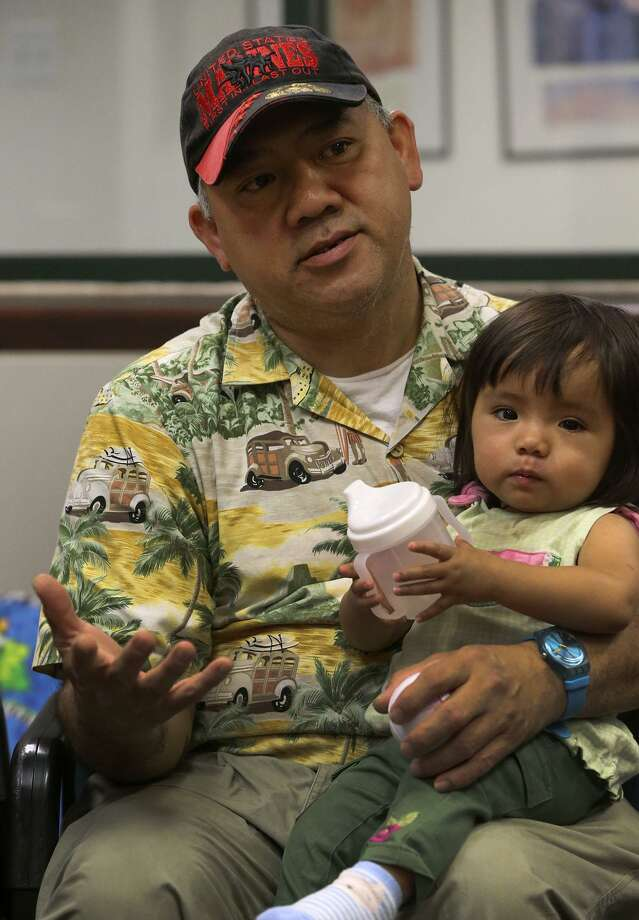 Veteran Eli Lequang is a widower whose wife died at the age of 34 when she was giving birth to his daughter Kayleen, 1. The Children's Shelter is offering new programs that are helping Lequang and other active or retired military who are in similar situations. Photo: John Davenport /San Antonio Express-News / ©San Antonio Express-News/John Davenport
