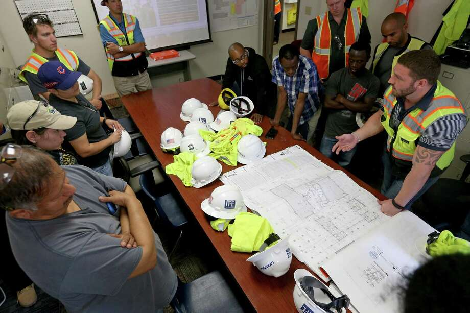Skanska Project Engineer Josh Carroll (right) shows St. Philip's College construction technology students construction plans for the Turbon Student Center renovation project before a tour of the site held Monday Nov. 7, 2016 at the college. Photo: Edward A. Ornelas /San Antonio Express-News / © 2016 San Antonio Express-News