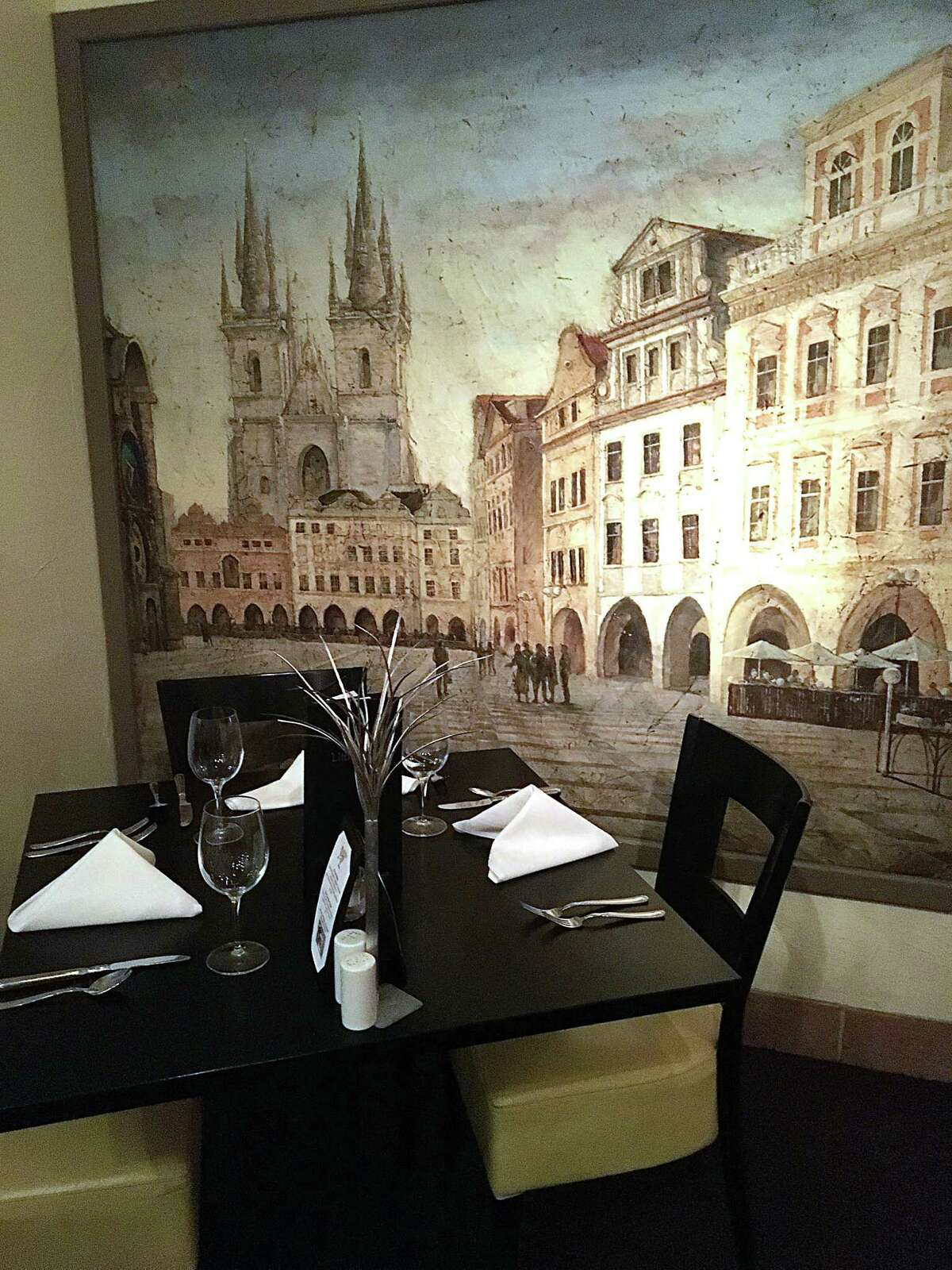 Against one wall at Little Gretel in Boerne is a painting of a street scene in Prague, playing homage to the restaurant's Czech roots.