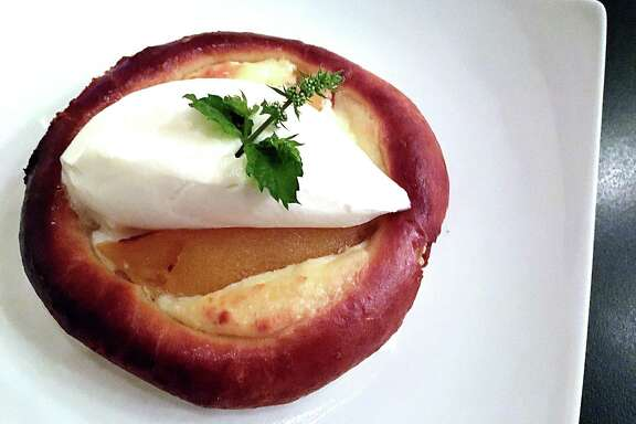 A Czech kolach at Little Gretel in Boerne with farmer's cheese, peaches and chantilly cream.