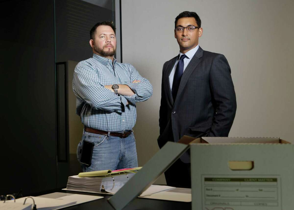 Jeff Russo, left, and his lawyer Neal Sarkar pose at the office at 1221 McKinney, Tuesday, Nov. 1, 2016, in Houston. Russo has been in a three year legal battle over a non-compete agreement. ( Melissa Phillip / Houston Chronicle )