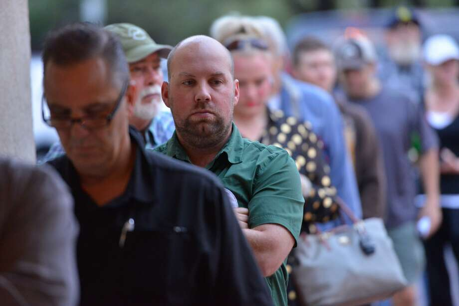 Patrick Murphy waits in line to vote early Tuesday morning in Hollywood Park. Photo: Robin Jerstad / San Antonio Express-News