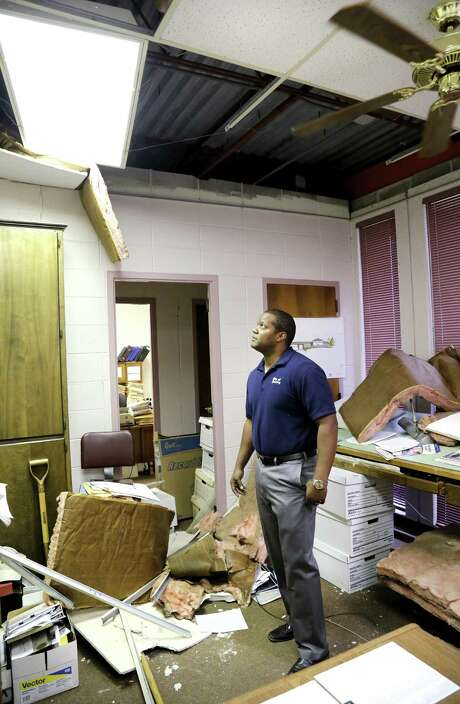 Jeremy Frazier, Cushing assistant city manager, stands in his office littered with insulation, ceiling tiles and debris after Sunday night's 5.0 magnitude earthquake in Cushing, Okla. The Oklahoma Corporation Commission is ordering seven Arbuckle wells be shut-in, while requiring that wastewater volumes be reduced to 25 percent in 16 sites and limited to the average for the past month in another 31 wells, says agency spokesman Matt Skinner. Photo: Jim Beckel /The Oklahoman / The Oklahoman