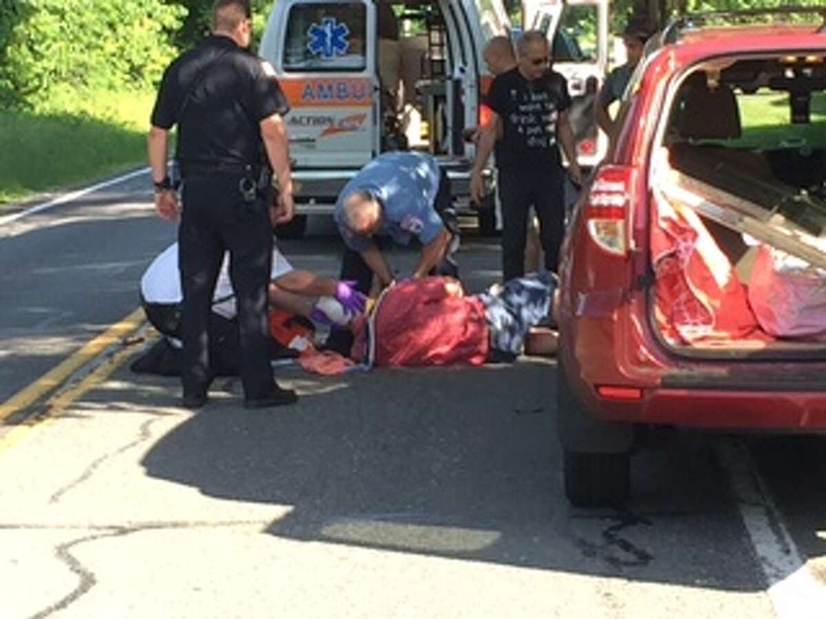 The Rev. Don Paine is attended to by emergency medical technicians after he was struck by a car and fractured his pelvis and other bones on Father's Day, 2015 (Photo courtesy of Don Paine)