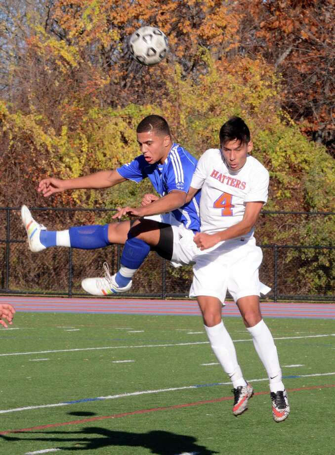 Fairfield Ludlowe's Tarcio Almeida and Danbury High School's Felipe Dos Reis fight for control of the ball during the Class LL First Round game at Danbury on Tuesday, Nov. 8, 2016. Photo: Lisa Weir / For Hearst Connecticut Media / The News-Times Freelance