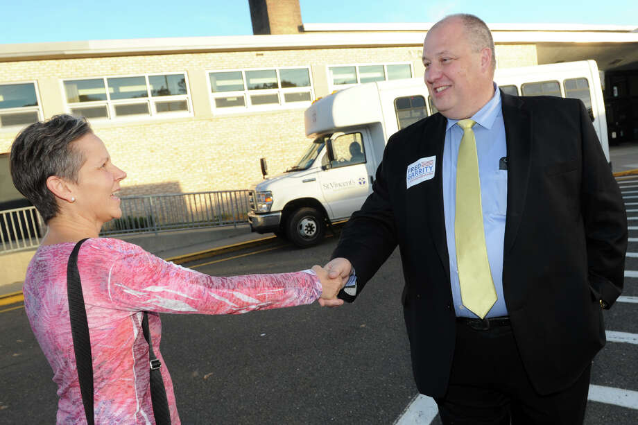 Fred Garrity, democratic candidate from Trumbull in the 134th State Rep. District, greets voters outside Middlebrook School in Trumbull, Conn. Nov. 8, 2016. Photo: Ned Gerard, Hearst Connecticut Media / Connecticut Post