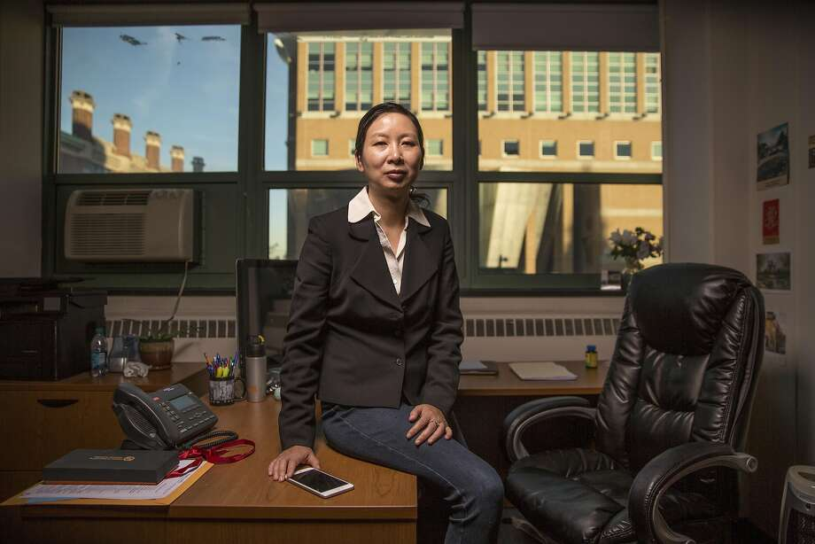 11/08/2016, Hoboken, NJ, Photos of Dr. Yingying Chen, who is a professor in the Department of Electrical and Computer Engineering at Stevens Institute of Technology, in her office. Dr. Chen has done research in cyber security and mobile devices. Her latest research has revealed that smart watches and fitness watches can be hacked. Hacking these kinds of devices make transactions at ATM's vulnerable. Photo: Fred R. Conrad