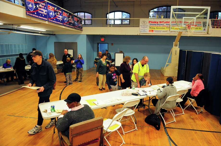 Residents wait in lines to vote inside the gym of the old Ansonia Armory in Ansonia, Conn., on Tuesday Nov. 8, 2016. Photo: Christian Abraham, Hearst Connecticut Media / Connecticut Post