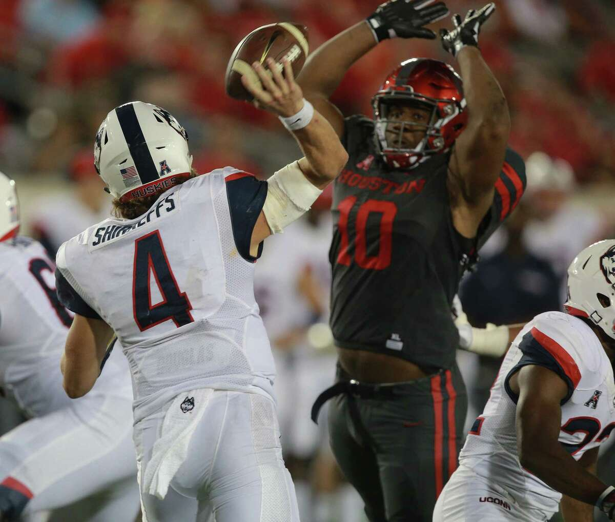 HOUSTON, TX - SEPTEMBER 29: Bryant Shirreffs #4 of the Connecticut Huskies has is pass attempt knocked down by Ed Oliver #10 of the Houston Cougars in the fourth quarter on September 29, 2016 in Houston, Texas. (Photo by Bob Levey/Getty Images)