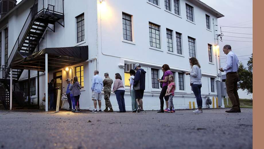Voters wait to enter the Alamo Height Baptist church to vote, Tuesday, Nov. 8, 2016, in San Antonio.  The polls have opened in Texas as voters make their choices for president and other elected offices.  (AP Photo/Eric Gay) Photo: Eric Gay, Associated Press