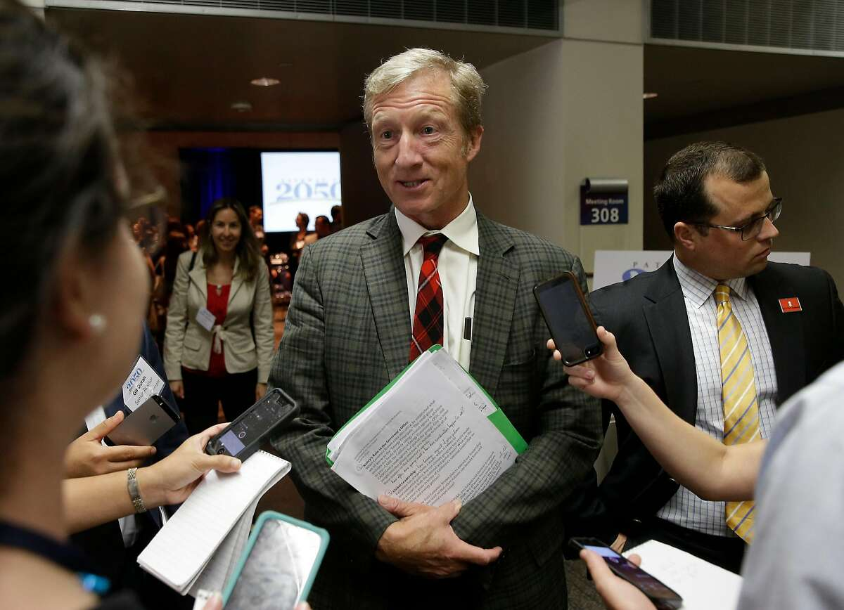 In this photo taken Thursday, Aug. 20, 2015, billionaire Tom Steyer talks with reporters in Sacramento, Calif. Steyer, on Wednesday, announced joining an effort to raise California's cigarette tax by $2 per pack through a ballot initiative. (AP Photo/Rich Pedroncelli)