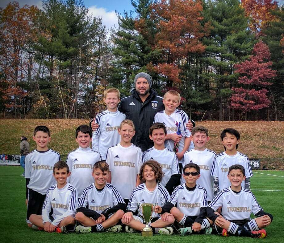 The Trumbull United U-11 Scorpions became the first boys' travel team from the town at any age level to win the fall CJSA Connecticut Cup with a 5-3 win in the finals over league rival Old Greenwich on Saturday. The Scorpions won six consecutive games over a seven-week span. Team members include, front row, from left, Jack Carlos, Christian Moura, Kevin Seymour, Claudio Pizzicarola and Kyle Kegan; second row, Hayden Brill, Dylan Moreira, Stefan Cordas, Jack DiGiovanni, Logan Blazer and Lander Sotil; third row, Owen Bull, coach Mark Moura and Sean Newmark. Photo: Contributed Photo / Connecticut Post Contributed