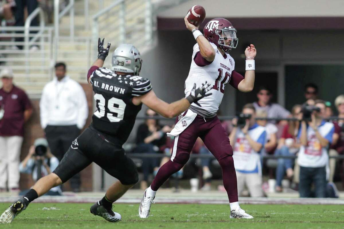 A&M quarterback Jake Hubenak was pressed into action last week at Mississippi State and threw two touchdown passes and one interception.