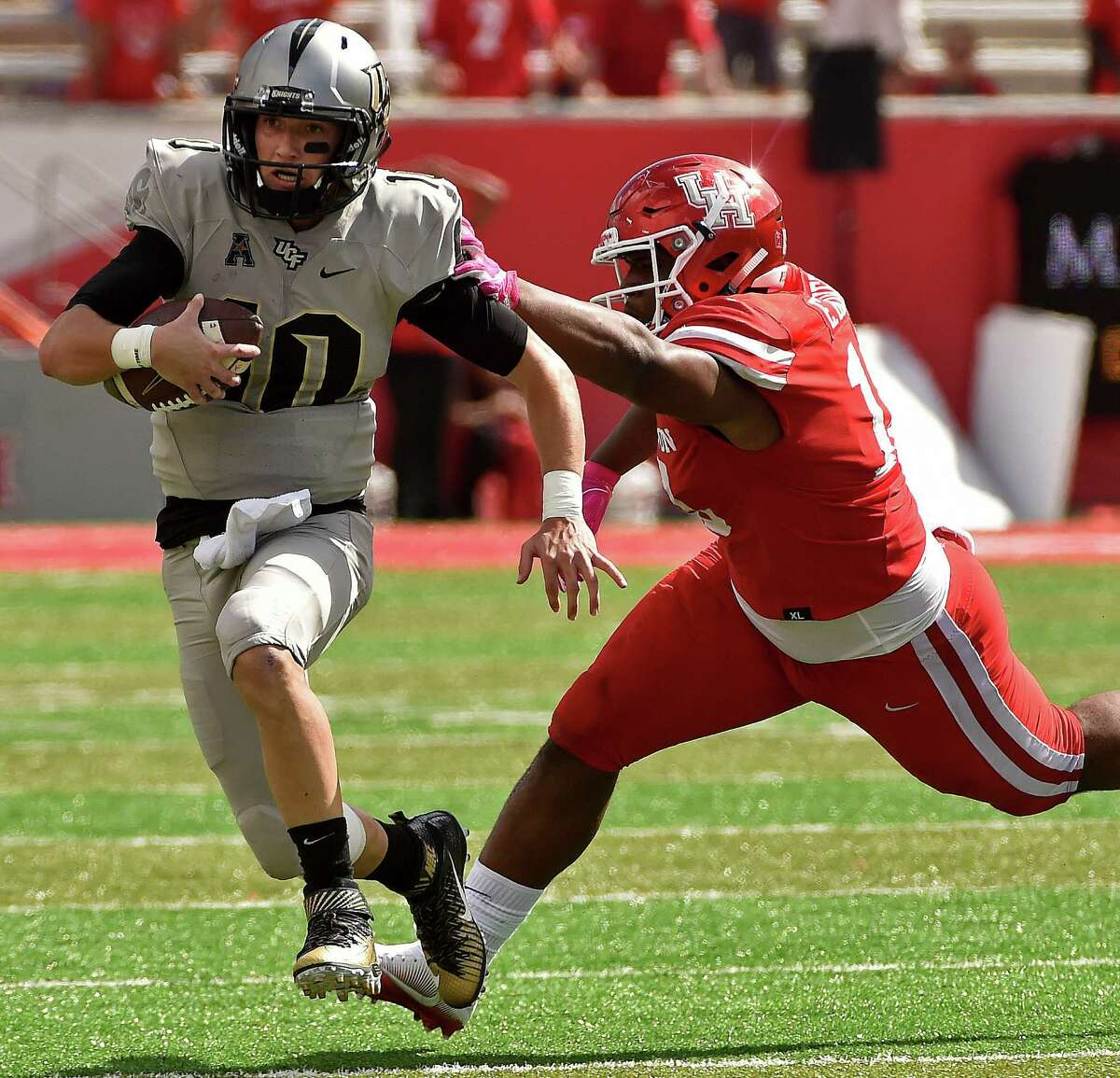 UH's Ed Oliver, right, is fourth nationally among defensive linemen with 52 tackles as a true freshman.