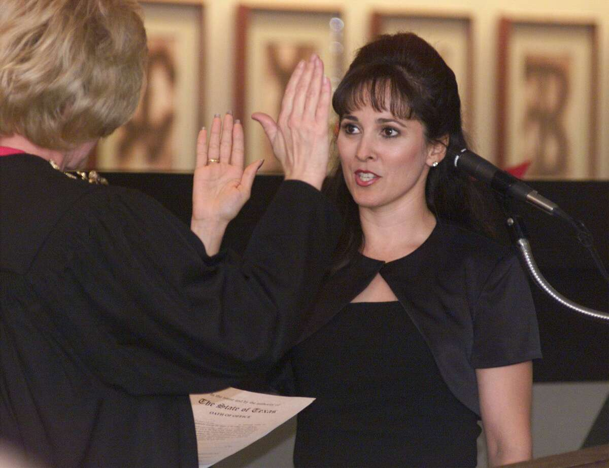 Irene Rios (right), pictured in 1999 getting sworn in as a judge of County Court at Law in Bexar County, was leading in the race for 4th Court of Appeals on Tuesday night.