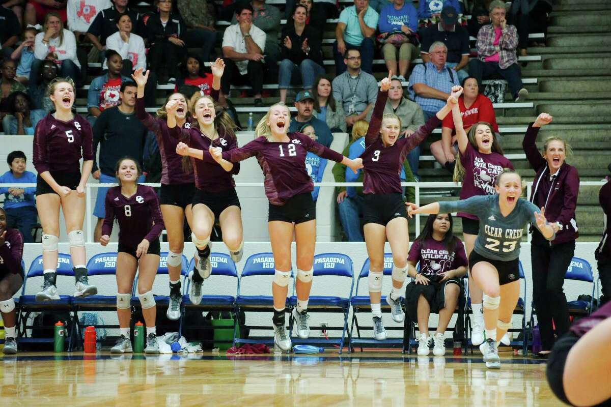 Clear Creek volleyball players celebrate after their win over Dawson Tuesday night that sends the Lady Wildcats to the Region 3-6A tourney.