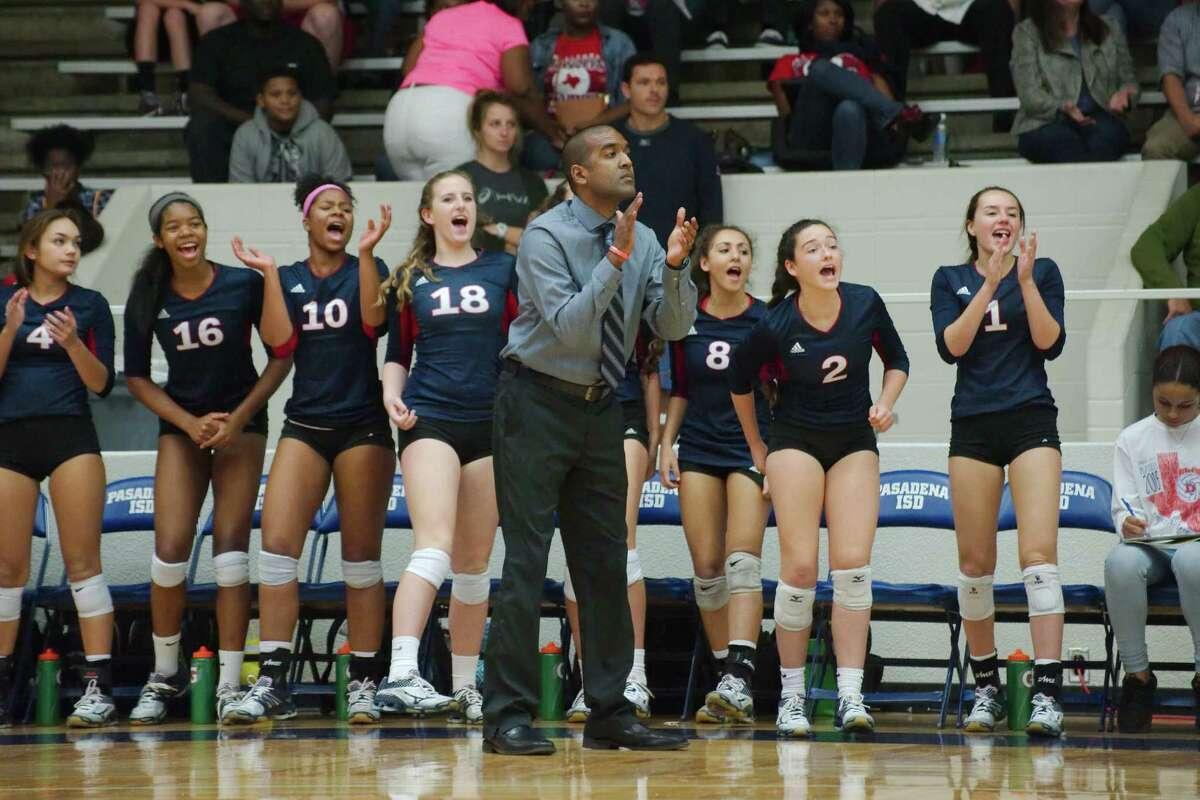 Dawson head coach Jason Karim tries to encourage his team in its Class 6A volleyball playoff match Tuesday night against Clear Creek.