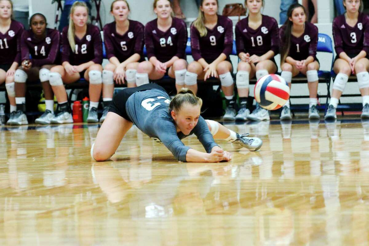 Clear Creek's Maddie Flora goes low to make a dig Tuesday night in the Lady Wildcats' straight set win over Dawson.