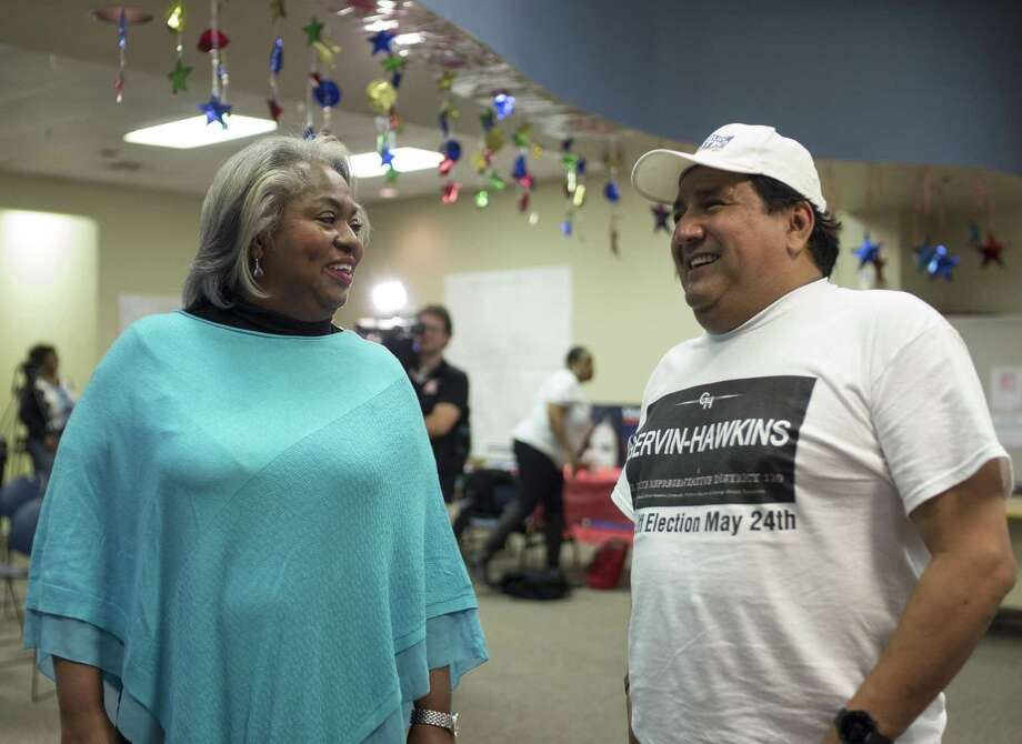Barbara Gervin-Hawkins, left, speaks with supporter Ramon Chapa, Jr. during an election night event, Tuesday, Nov. 8, 2016, at her campaign headquarters in San Antonio. (Darren Abate/For the Express-News) Photo: Darren Abate, FRE / Darren Abate/San Antonio Express-News / DarrenAbateMedia