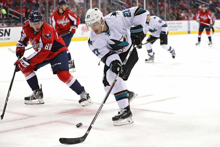 Right wing Joonas Donskoi, who was on the ice for two of the Sharks' three goals, skates past Nate Schmidt in the first period of San Jose's 3-0 victory in Washington. Photo: Patrick Smith, Getty Images
