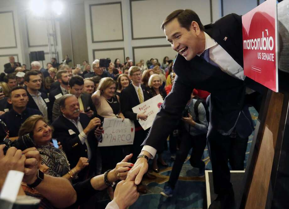 Florida Republican Sen. Marco Rubio greets supporters after winning a second term in office, Tuesday, Nov. 8, 2016 in Miami. Rubio defeated U.S. Rep. Patrick Murphy, a two-term congressman. (AP Photo/Wilfredo Lee) Photo: Wilfredo Lee, Associated Press