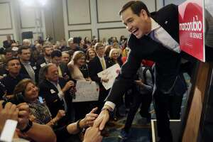 Florida Republican Sen. Marco Rubio greets supporters after winning a second term in office, Tuesday, Nov. 8, 2016 in Miami. Rubio defeated U.S. Rep. Patrick Murphy, a two-term congressman. (AP Photo/Wilfredo Lee)