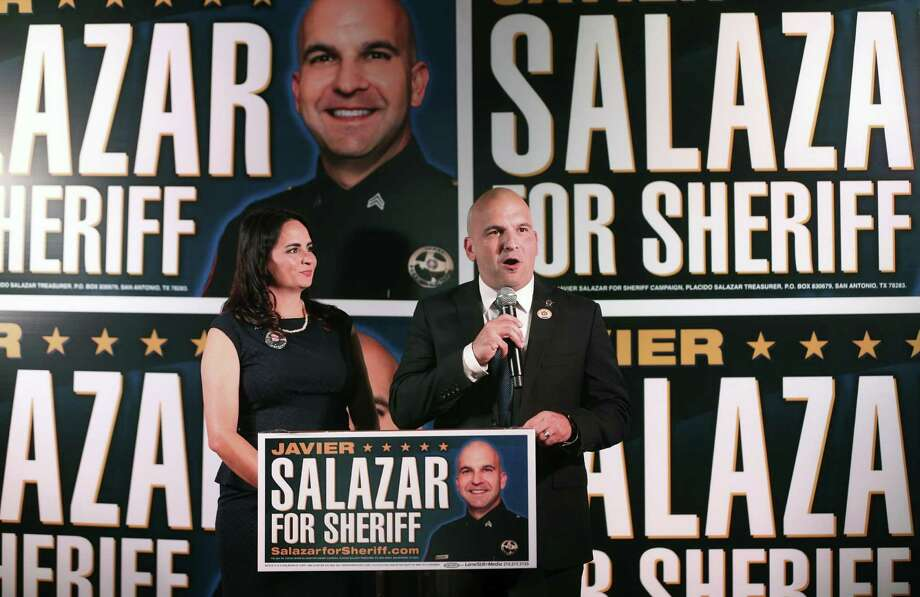 Bexar County Sheriff candidate Javier Salazar, flanked by his wife Sarah, talks Tuesday, Nov. 8, 2016 at the Cadillac Bar to his supporters after early voting results showed him just two percent behind incumbent Susan Pamerleau. Photo: William Luther, Staff / San Antonio Express-News / © 2016 San Antonio Express-News