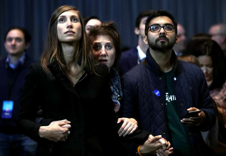 NEW YORK, NY - NOVEMBER 08:  People hold hands as they watch voting results at Democratic presidential nominee former Secretary of State Hillary Clinton's election night event at the Jacob K. Javits Convention Center November 8, 2016 in New York City. Clinton is running against Republican nominee, Donald J. Trump to be the 45th President of the United States.