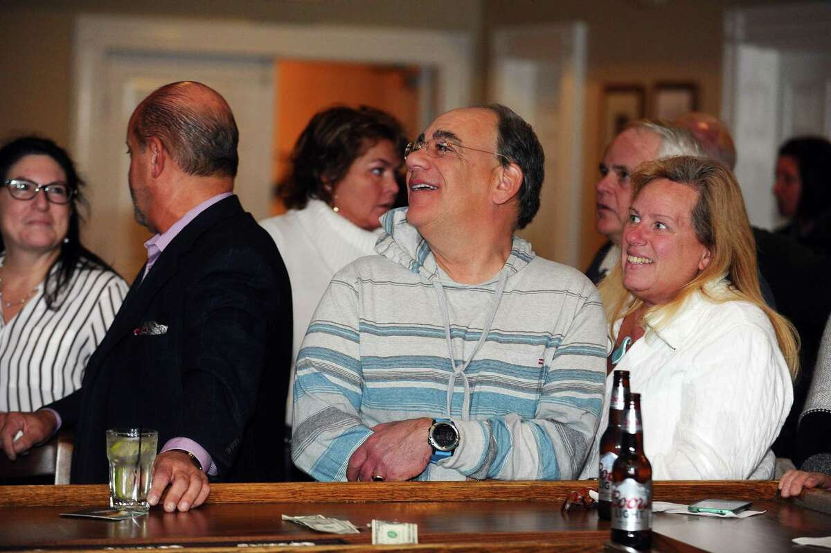 Gino Bottino (center), the Republican challenger to incumbent Carlo Leone in the District 27 Senate race, watches the early poll numbers roll in at the Republican Town Committee election night viewing party at Hibernian Hall in downtown Stamford, Conn. on Tuesday, Nov. 8, 2016.